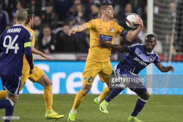 Pieros Sotiriou of Apoel FC Frank Acheampong of RSC Anderlechtduring the UEFA Europa League round of 16 match between RSC Anderlecht and APOEL on...