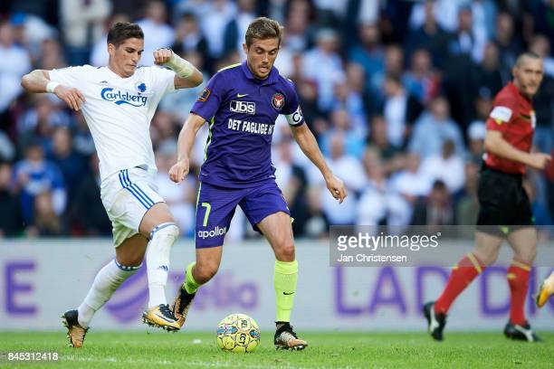 Pieros Sotiriou of FC Copenhagen and Jakob Poulsen of FC Midtjylland compete for the ball during the Danish Alka Superliga match between FC...