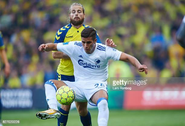 Pieros Sotiriou of FC Copenhagen and Kasper Fisker of Brondby IF compete for the ball during the Danish Alka Superliga match between Brondby IF and...