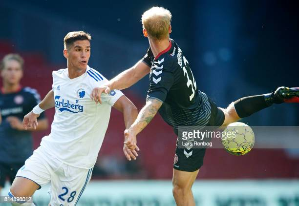 Pieros Sotiriou of FC Copenhagen and Kasper Pedersen of AaB Aalborg compete for the ball during the Danish Alka Superliga match between FC Copenhagen...