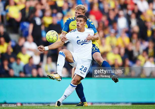 Pieros Sotiriou of FC Copenhagen and Paulus Arajuuri of Brondby IF compete for the ball during the Danish Alka Superliga match between Brondby IF and...