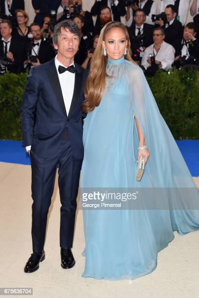 Pierpaolo Piccioli and Jennifer Lopez attend the 'Rei Kawakubo/Comme des Garcons Art Of The InBetween' Costume Institute Gala at Metropolitan Museum...