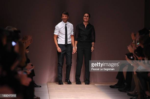 Pierpaolo Piccioli and Maria Grazia Chiuri walk the runway during the Valentino Spring / Summer 2013 show as part of Paris Fashion Week at Espace...