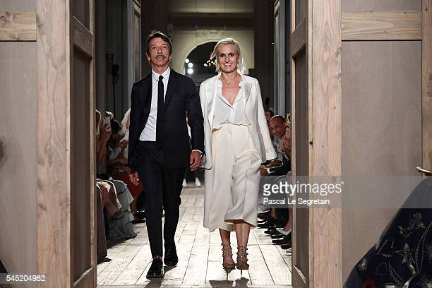 Pierpaolo Piccioli and Maria Grazia Chiuri walk the runway during the Valentino Haute Couture Fall/Winter 20162017 show as part of Paris Fashion Week...