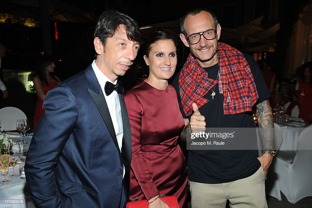 Pierpaolo Piccioli, <a gi-track='captionPersonalityLinkClicked' href=/galleries/search?phrase=Maria+Grazia+Chiuri&family=editorial&specificpeople=5551257 ng-click='$event.stopPropagation()'>Maria Grazia Chiuri</a> and <a gi-track='captionPersonalityLinkClicked' href=/galleries/search?phrase=Terry+Richardson&family=editorial&specificpeople=758714 ng-click='$event.stopPropagation()'>Terry Richardson</a> attends Cash & Rocket On Tour Women for Women - Gala Dinner and Auction on June 16, 2013 in Rome, Italy.