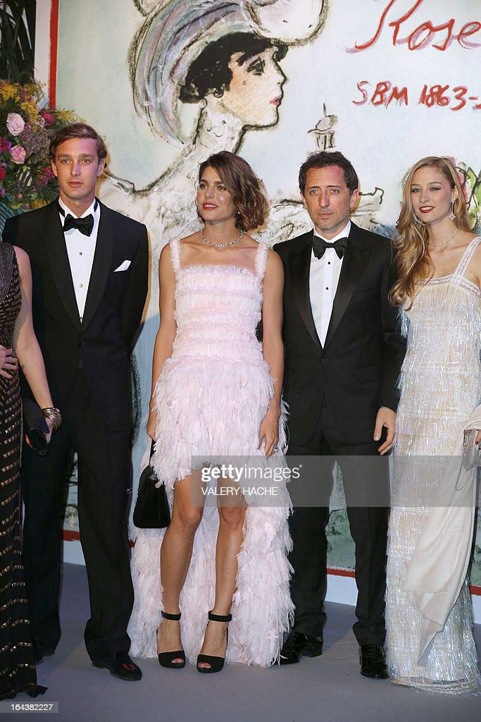 Pierre and Charlotte Casiraghi, French humorist Gad Elmaleh and Countess Beatrice Borromeo pose prior to the annual Rose Ball at the Monte-Carlo Sporting Club in Monaco, on March 23, 2013. The Rose Ball is one of the major charity events in Monaco. Created in 1954, it benefits the Princess Grace Foundation. Directed by German Couturier Karl Lagerfeld, this year's event named 'La Belle Epoque' (Beautiful Era), was celebrated in honor of the Societe des bains de mer (SBM), a prominent player in Monaco's tourism industry.