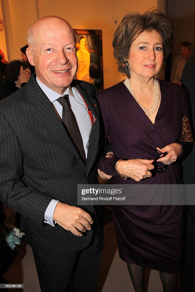 Pierre Arizzoli-Clementel (L) and Marquise Roland du Luart attend a dinner in honor of Helene David-Weill, who presided through 1994 - 2012 Les Arts Decoratifs, one of the largest decorative arts museums in the world, at Sotheby's on January 28, 2013 in Paris, France.