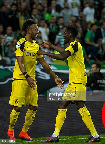 Pierre Aubameyang and Ousmane Dembélé of Borussia Dortmund celebrates after scores a goal against SC Sporting during the UEFA Champions League...