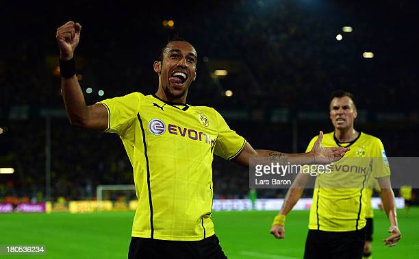 Pierre Aubameyang of Dortmund celebrates after scoring his teams third goal during the Bundesliga match between Borussia Dortmund and Hamburger SV at...