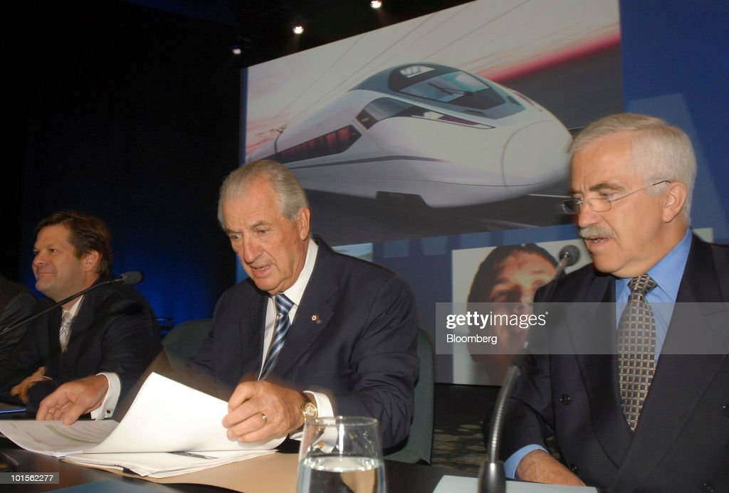Pierre Beaudoin, president and chief executive officer of Bombardier Inc., left, Laurent Beaudoin, the company chairman, center, and Roger Carle, the corporate secretary, prepare for a presentation at the annual shareholders meeting in Montreal, Canada, on Wednesday, June 2, 2010. Bombardier Inc., the world's third-largest commercial planemaker, said first-quarter profit fell 3.2 percent as the economic crisis curbed demand for business and regional jets. Photographer: John Morstad/Bloomberg via Getty Images