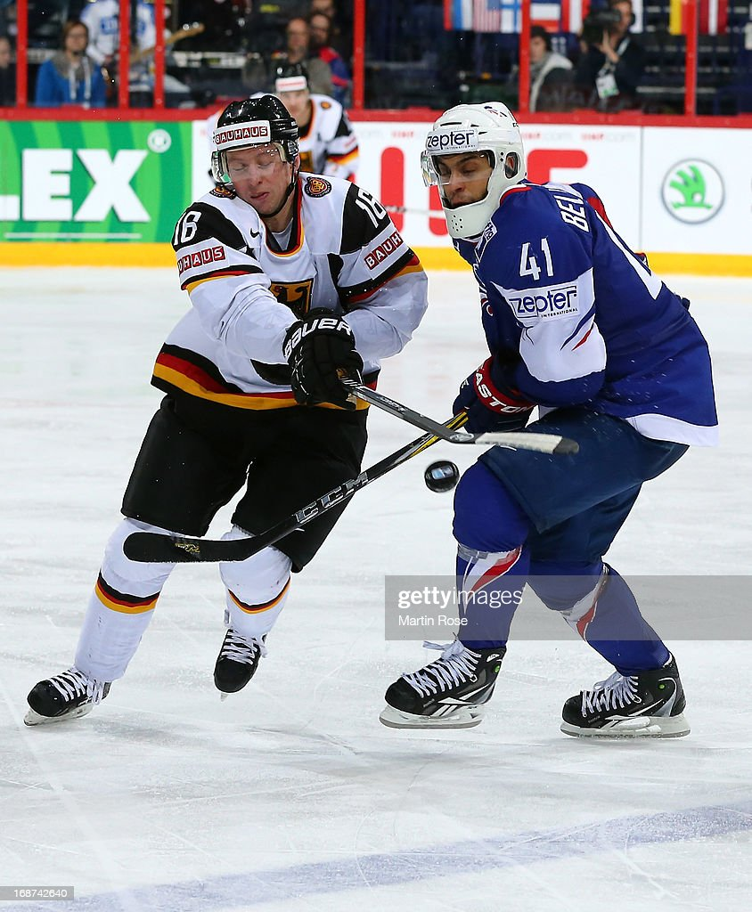 Pierre Bellemare (R) of France and Michael Wolf (R) of Germany battle for the puck during the IIHF World Championship group H match between France and Germany at Hartwall Areena on May 14, 2013 in Helsinki, Finland.