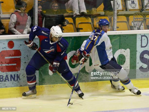 Pierre Bellemare of France vies with Alexey Koledayev of Kazakhstan in an Olympic qualification game 13 February 2005 in Klagenfurt Austria / AFP...