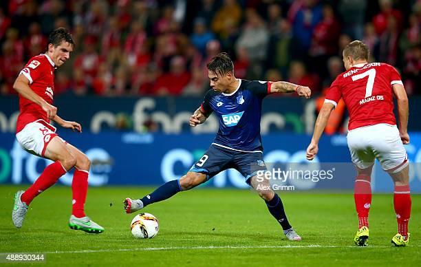 Pierre Bengtsson of Mainz and Eduardo Vargas of Hoffenheim battle for the ball during the Bundesliga match between 1 FSV Mainz 05 and 1899 Hoffenheim...