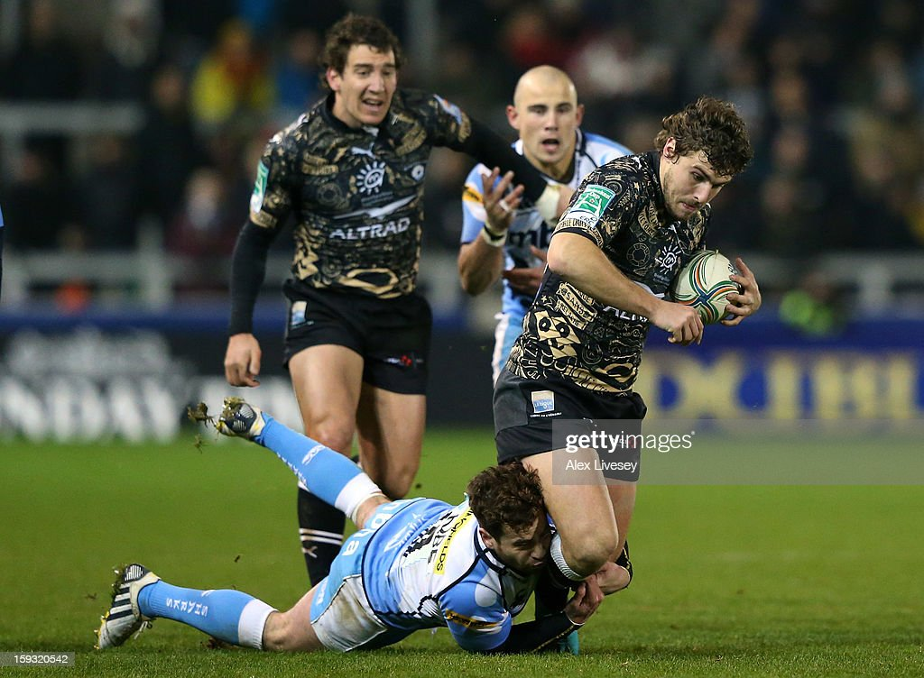 Pierre Berard of Montpellier is tackled by Danny Cipriani of Sale Sharks during the Heineken Cup Pool 6 match between Sale Sharks and Montpellier at Salford City Stadium on January 11, 2013 in Salford, England.