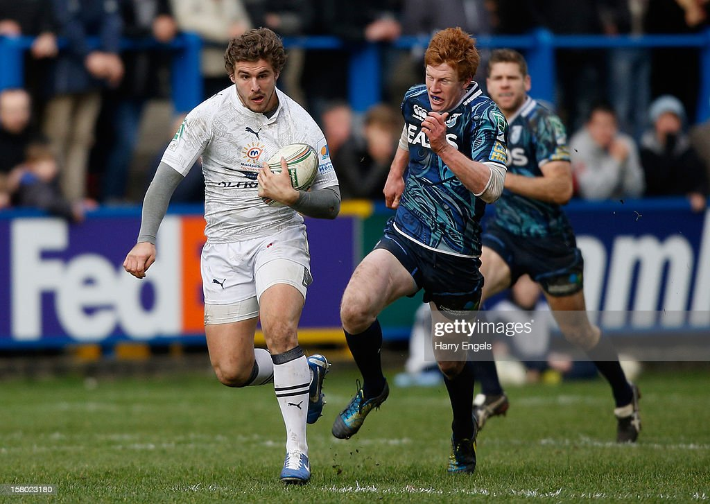 Pierre Berard of Montpellier outpaces Rhys Patchell of Cardiff Blues during the Heineken Cup match between Cardiff Blues and Montpellier at Cardiff Arms Park on December 9, 2012 in Cardiff, Wales.