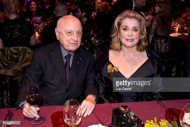 Pierre Berge and Catherine Deneuve attend the the Sidaction Gala Dinner 2015 on January 29 2015 in Paris France