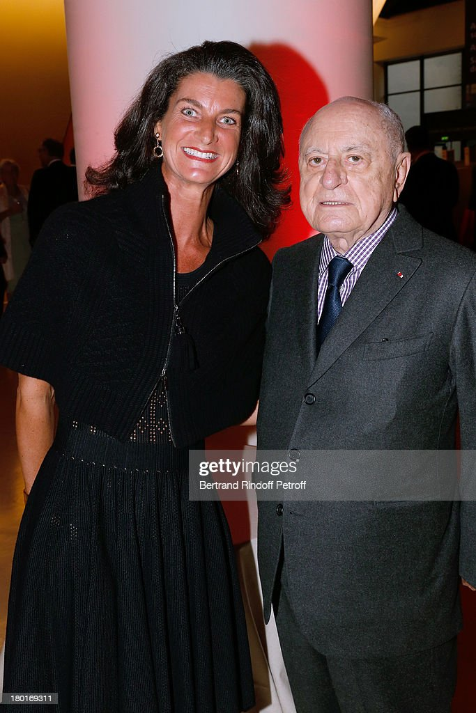 Pierre Berge (R) and Evelyne de Rochefort attend 'Friends of Quai Branly Museum Society' dinner party at Musee du Quai Branly on September 9, 2013 in Paris, France.