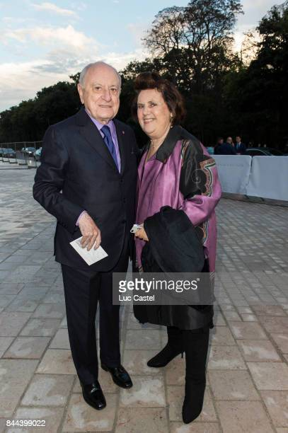 Pierre Berge and Suzie Menkes standing at the Louis Vuitton Foundation on October 20 2014 in Paris France