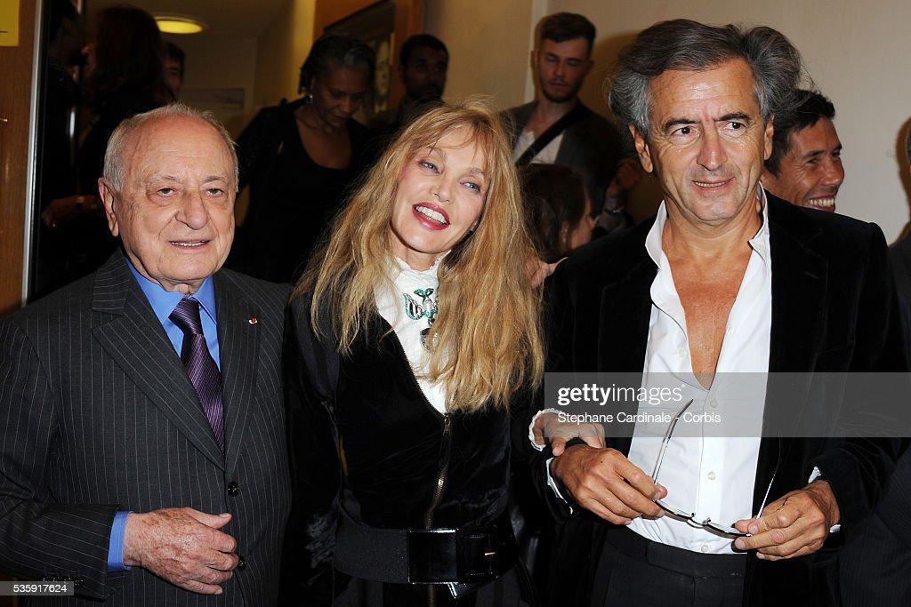 Pierre Berge, Arielle Dombasle and Bernard-Henri Levy attend the premiere of 'L'Amour Fou - Yves Saint Laurent - Pierre Berge' in Paris.