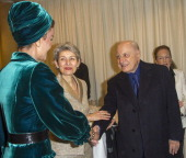 Pierre Berge greets Sheikha Mozah the wife of the Emir of Qatar as UNESCO Secretary General Irina Bokova looks on as they attend Placido Domingo's...