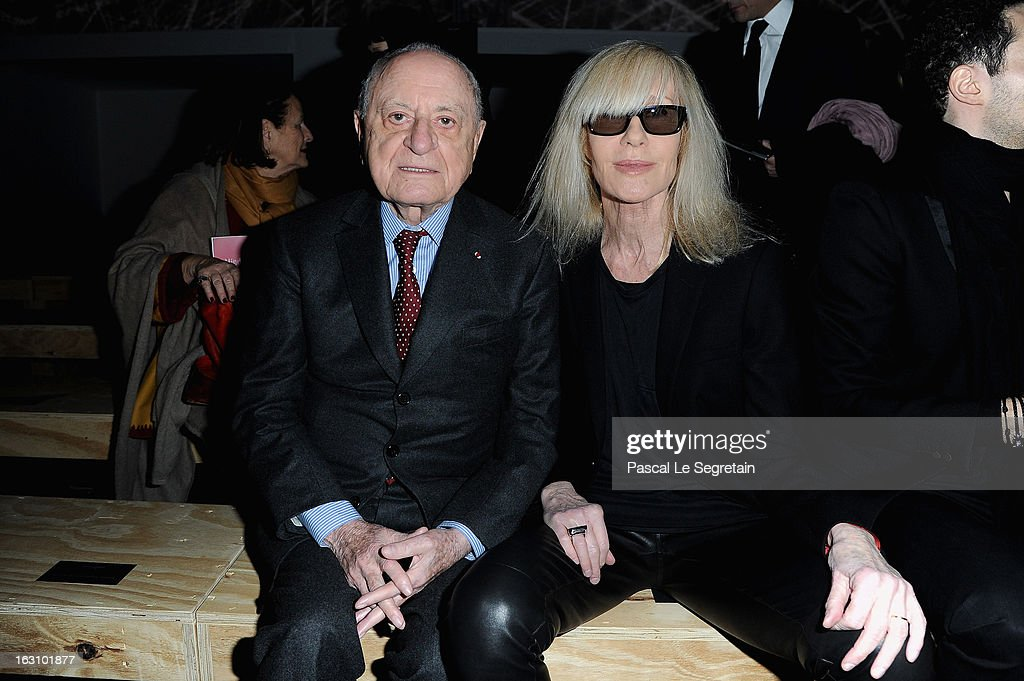 Pierre Berger and <a gi-track='captionPersonalityLinkClicked' href=/galleries/search?phrase=Betty+Catroux&family=editorial&specificpeople=765143 ng-click='$event.stopPropagation()'>Betty Catroux</a> attend the Saint Laurent Fall/Winter 2013 Ready-to-Wear show as part of Paris Fashion Week on March 4, 2013 in Paris, France.