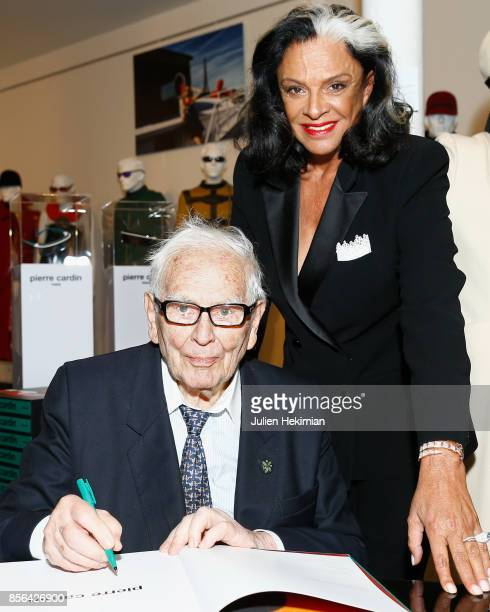 Pierre Cardin dedicates a book to Betty Lagardere during the 'Pierre Cardin' By JeanPascal Hesse Book Signing At Pierre Cardin Museum as part of the...