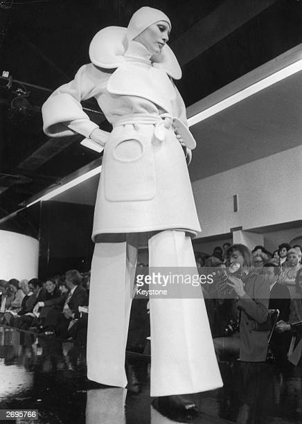 A Pierre Cardin trouser suit in powder grey The threequarter length jacket has a very large collar running through to lapels in one piece worn with...