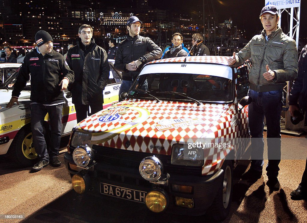 Pierre Casighari, son of Princess Caroline of Hanover (R) and co-pilot Jean-Thierry Besins (3R),Driver Daniel Elena (L) and his copilot Olivier Campana (2) pose beside Casighari's vehicle at the start of the 16th edition of the Monte-Carlo Historic Rally in Monaco on January 27, 2013. In keeping with tradition, competitors may choose their starting point from several cities, subject to numbers: Warsaw, Copenhagen, Glasgow, Rheims, Barcelona or Monte Carlo.