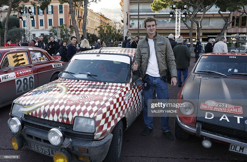 Pierre Casighari, son of Princess Caroline of Hanover poses beside his vehicle at the special arrival of the 16th edition of the Monte-Carlo Historic Rally in Monaco on January 31, 2013. In keeping with tradition, competitors may choose their starting point from several cities, subject to numbers: Warsaw, Copenhagen, Glasgow, Rheims, Barcelona or Monte Carlo. AFP PHOTO / VALERY HACHE