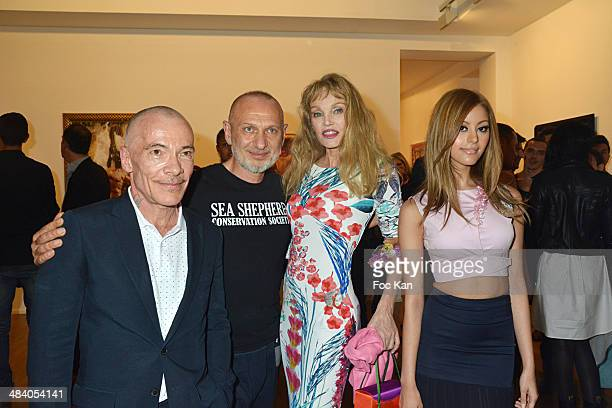 Pierre Commoy Gilles Blanchard Arielle Dombasle and Zahia Dehar attend the 'Heros' Pierre et Gilles Exhibition At Galerie Templon on April 10 2014 in...
