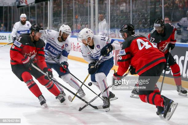 Pierre Edouard Bellemare and Stephane da Costa of France try to get the puck against Sean Couturier Chris Lee and Wayne Simmonds of Canada during the...