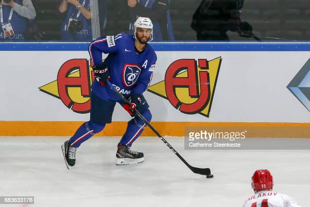 Pierre Edouard Bellemare of France looks to pass the puck during the 2017 IIHF Ice Hockey World Championship game between France and Belarus at...