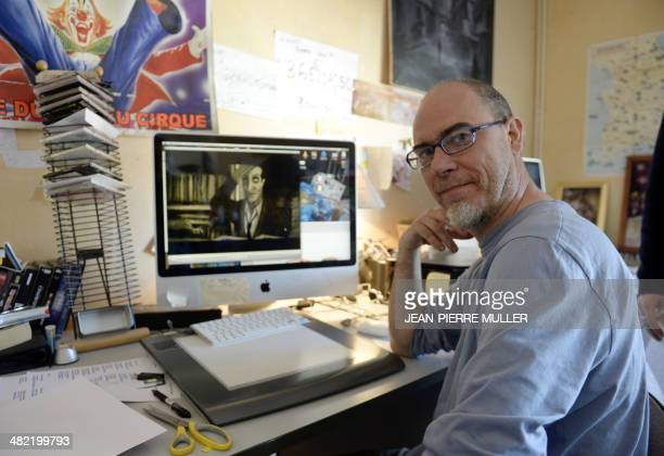 Pierre Elissalde founder and producer of the animation studio 'Les Trois Ours' poses in Angouleme central France on March 17 next to a computer with...