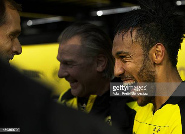 Pierre Emerick Aubameyang of Borussia Dortmund is congratulated is congratulated by Thomas Tuchel Head Coach after victory in the Bundesliga match...