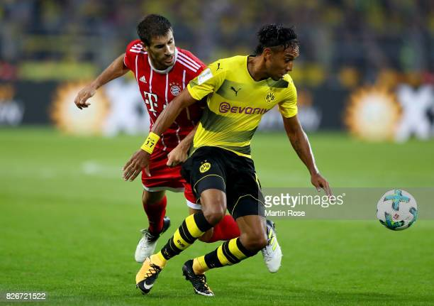 Pierre Emerick Aubameyang of Dortmund and Javier Martinez of Muenchen battle for the ball during the DFL Supercup 2017 match between Borussia...