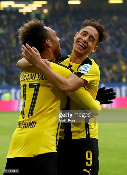 Pierre Emerick Aubameyang of Dortmund celebrate with team mate Emre Mor after scoring the opening goal during the Bundesliga match between Hamburger...
