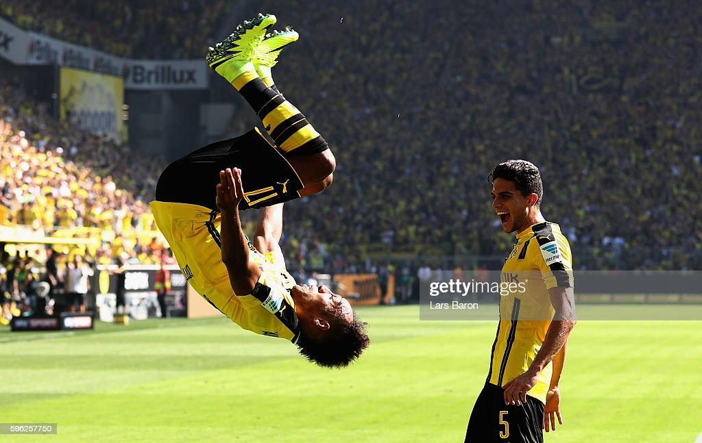 Pierre Emerick Aubameyang of Dortmund celebrates after scoring his teams first goal during the Bundesliga match between Borussia Dortmund and 1. FSV Mainz 05 at Signal Iduna Park on August 27, 2016 in Dortmund, Germany.