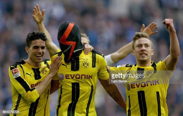 Pierre Emerick Aubameyang of Dortmund celebrates after scoring his teams first goal during the Bundesliga match between FC Schalke 04 and Borussia...