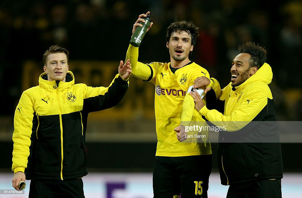 Pierre Emerick Aubameyang of Dortmund celebrates with team mates Marco Reus and Mats Hummels after winning the UEFA Europa League Round of 16 first leg match between Borussia Dortmund and Tottenham Hotspur at Signal Iduna Park on March 10, 2016 in Dortmund, Germany.