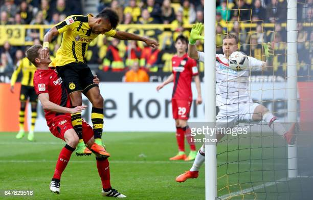 Pierre Emerick Aubameyang of Dortmund heads his teams third goal during the Bundesliga match between Borussia Dortmund and Bayer 04 Leverkusen at...