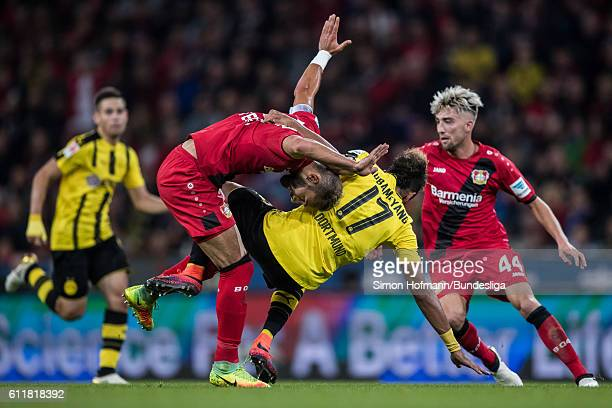 Pierre Emerick Aubameyang of Dortmund is challenged by Jonathan Tah of Leverkusen during the Bundesliga match between Bayer 04 Leverkusen and...
