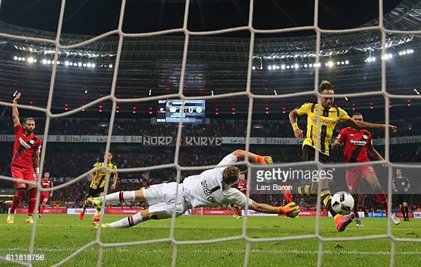 Pierre Emerick Aubameyang of Dortmund scores an offside goal against goalkeeper Bernd Leno of Leverkusen during the Bundesliga match between Bayer 04...