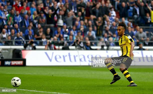 Pierre Emerick Aubameyang of Dortmund scores his teams first goal during the Bundesliga match between FC Schalke 04 and Borussia Dortmund at...