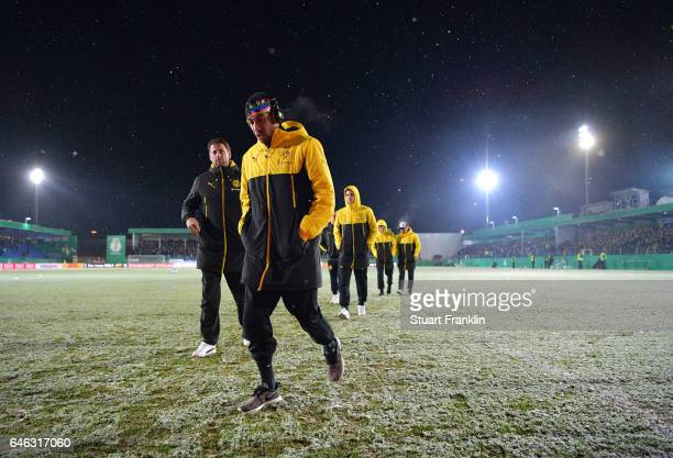 Pierre Emerick Aubameyang of Dortmund walks on the pitch as the game is called off due to an unplayable pitch prior to the DFB Cup quarter final...