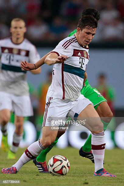 Pierre Emile Hoejbjerg of Munich during the Telekom Cup 2014 match between FC Bayern Muenchen and Borussia Moenchengladbach at Imtech Arena on July...