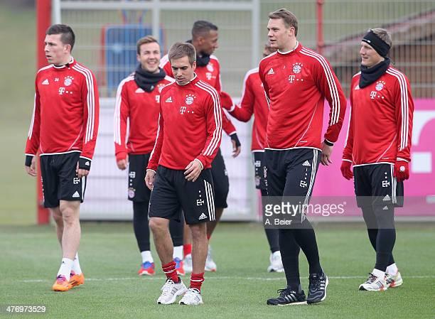 Pierre Emile Hojbjerg Mario Goetze Philipp Lahm Jerome Boateng David Alaba goalkeeper Manuel Neuer and Bastian Schweinsteiger of Bayern Muenchen warm...
