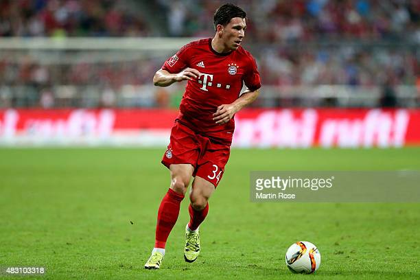 Pierre Emile Hojbjerg of FC Bayern Muenchen runs with the ball during the Audi Cup 2015 final match between FC Bayern Muenchen and Real Madrid at...