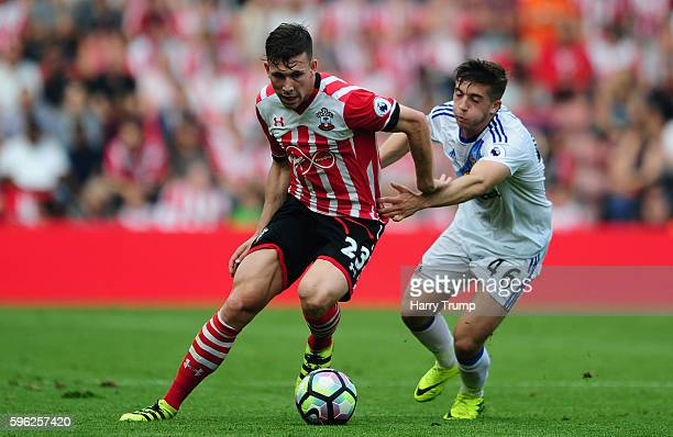 Pierre Emile Hojbjerg of Southampton is tackled by Lynden Gooch of Sunderland during the Premier League match between Southampton and Sunderland at...
