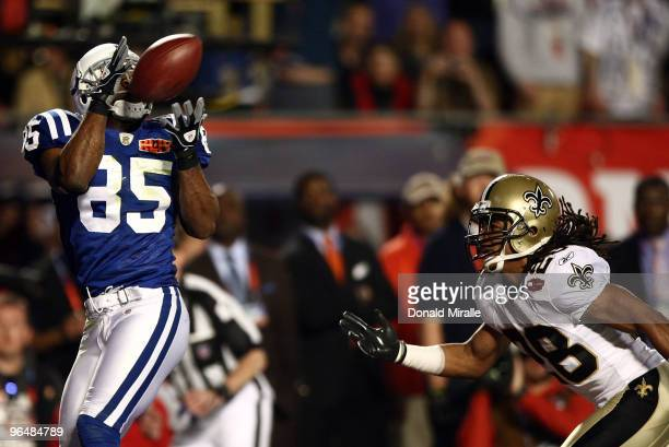 Pierre Garcon of the Indianapolis Colts catches a touchdown pass in the first quarter against the New Orleans Saints during Super Bowl XLIV on...