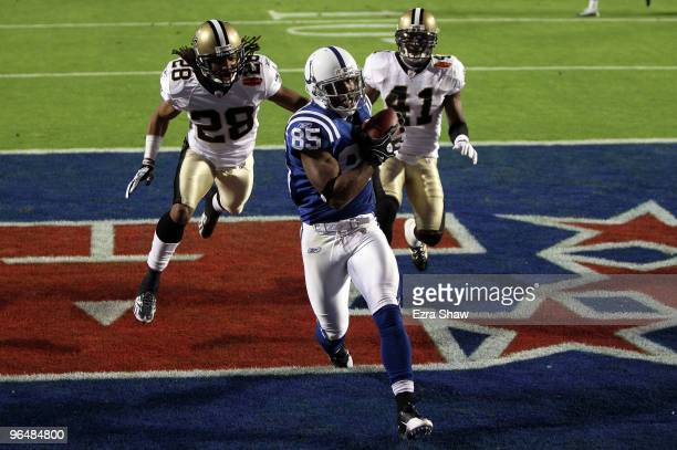 Pierre Garcon of the Indianapolis Colts makes a catch for a touchdown against the New Orleans Saints during the first quarter Super Bowl XLIV on...